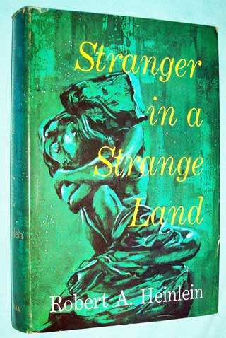 Photo of a hard cover book with dust Jacket, Stranger In A Strange land by Robert A. Heinlein, Book Club Edition, front