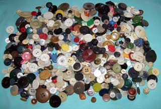 Photo showing 1 lb 1 oz. of vintage buttons, spread out
