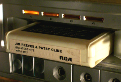 photo of an eight track tape inserted in the player to determine what channel is being played.