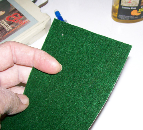 photo showing a felt pad that will be used to cut out the little pads we need for repair of the tape.