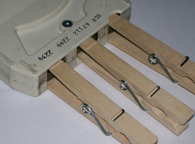 photo showing clothespins inserted - backwards - at front of tape opening.
