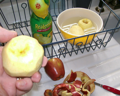 Photo of a peeled apple ready to be cored.