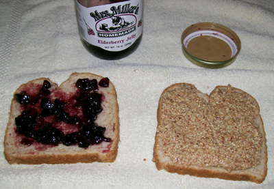 Photo showing a Peanut Butter and Jelly sandwich ready to eat.