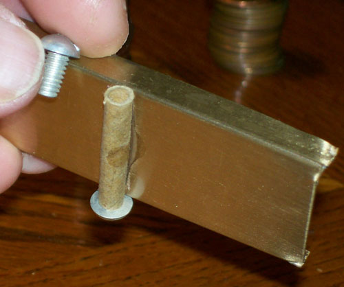 photo showing the fulcrum's manner of construction - a paperboard type thread protector Krazy Glued on the bottom of the platform and a bolt inserted at each side.
