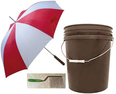 photo showing a 5 gallon bucket, a large golf umbrella and an Afro-pick.