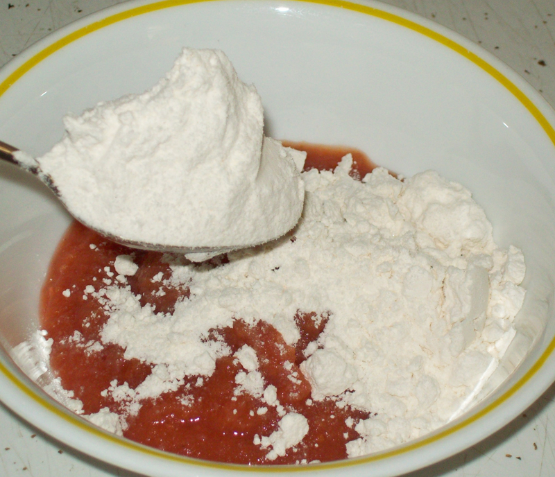 photo showing a 'heaping' spoonful of pancake mix.