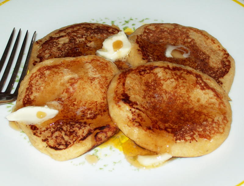 photo showing a group of crabapple pancakes, butter and maple syrup.